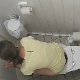 A daring voyeur cameraman peers over the stall wall and records an unsuspecting girl taking a shit and a piss while sitting on a toilet in a public restroom. Plops are clearly heard and poop is seen on her TP as she wipes. Over 3 minutes.