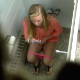 A hidden camera mounted in the ceiling records a blonde girl taking a shit and a piss in a public restroom while texting on her phone. Plop sounds are audible and we get a glimpse of her poop in the toilet. Presented in 720P HD video. Over 1.5 minutes.