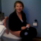 A girl is video-recorded as she poops while sitting on a toilet. Although we miss the plop, her finished product is briefly visible in the toilet at the end of the clip before she closes the lid and flushes.