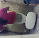 A voyeur cameraman records an unsuspecting woman from above in a public restroom stall as she takes a piss and shit into a toilet. Product seen in bowl when she stands up to wipe her ass. Over 6 minutes.