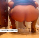 A woman takes a large shit while squatting over a glass bowl.