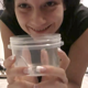 Mandy Flores takes a hard, clumpy shit into a plastic container without wearing any makeup. She uses her fingers to help pull out the sticky turd - most likely taken from a custom request. 720P HD. About 3 minutes.