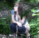 A pretty Eastern-European girl is recorded in voyeuristic fashion as she takes a piss and a tiny, soft shit in a wooded, outdoor location. Poop action is visible beneath her, but it is not a lot. She does not wipe when finished. 720P HD. Over 2 minutes.