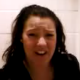 A brief, small, low-quality video clip of Mary Crap recording herself pooping while sitting on a toilet. She does not show her product when finished.