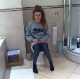 A British girl is recorded by her friend as she begins to shit while sitting on a toilet. Some crackling and plops are heard, and they laugh at the sounds. Over half a minute.