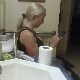 A mature, older blonde woman takes a gassy, runny shit while sitting on a toilet in her bathroom late at night. Great sounds for diarrhea fans! Presented in 720P HD. Over 2 minutes.