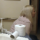 A mature, older blonde woman takes a runny shit and farts repeatedly while sitting on a toilet in her bathroom late at night. Some nose blowing, too. Presented in 720P HD. About 2.5 minutes.