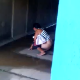 Some people video-record their female friend as she takes a shit in a storm tunnel. Video is brief, but you can see her turd on the ground afterward.