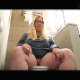 A fat, blonde woman wearing glasses pisses and shits while sitting on a toilet in 2 different scenes. Audible, but subtle pooping sounds with plops. In the first scene, she wipes her ass and shows us the dirty TP and product. About 7.5 minutes.
