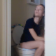A slender, young-looking girl records herself taking a piss and a morning shit while sitting on a toilet in her bathroom. Farts and subtle pooping sounds are heard. About 4.5 minutes.