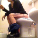 A short-haired brunette girl with dyed highlights sits down on a toilet, pisses a little and then shits with several audible, but subtle plops. She continues to smoke and relax before wiping her ass. About 3.5 minutes.