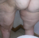 One of our users records his large wife taking a soft, runny shit into a toilet. She spreads her ass cheeks to show us the mess on her butt, and finished mess in toilet bowl is shown. About a minute.