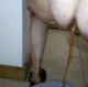 One of our users records his large wife taking a semi-solid shit into a bucket. She spreads her ass cheeks to push out a little more and show us her mess. The cameraman shows us her sloppy poop in the bucket. About a minute.