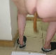 One of our users records his large wife taking a wet, sloppy shit onto a cardboard box. She spreads her ass to show us the mess. Finished product shown close up at end of video. Presented in 720P vertical HD format. Over 2.5 minutes.