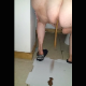One of our users records his large wife taking a wet, sloppy shit onto a cardboard box. She spreads her ass to show us the mess. Finished product shown close up at end of video. Presented in 720P vertical HD format. About a minute.