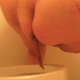 Ms. Poop Alot shits into a toilet while standing and bending over the bowl.