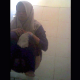 A Muslim girl wearing a hijab is recorded by a hidden camera as she takes a shit into a public floor toilet. A subtle plop is heard. Presented in 720P vertical HD format, although video quality is somewhat dark and grainy. Over 6 minutes.