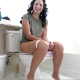 An attractive brunette woman records herself farting and shitting while sitting on a toilet at home. Pooping sounds are fully audible. Presented in 720P HD video.