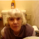 Someone video-records her British grandmother in the bathroom. She appears to be wiping her ass.
