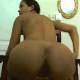 A pretty black girl takes a shit from the edge of a chair while spreading her ass cheeks. She shows us her poop on the floor when finished. Over 1.5 minutes.