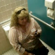 A big, fat girl is video recorded sitting on the toilet chattering about her cell phone. We are not sure if she is peeing, pooping, or both.