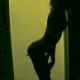 "A woman is seen as a shadow against a lighter background as she grows several ""tails"", which eventually ""drop off""."