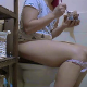 A plump, Eastern-European girl sits on a toilet and takes a gurgling, wet shit while eating a jar of Nutella. Subtle plops are heard as she continues to sit there. She is recorded from a side view perspective with her face out of view. About 5.5 minutes.
