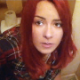 A pretty Eastern-European girl with red-dyed hair records herself taking a loud, soft, wet-sounding shit and a piss while sitting on a public restroom toilet. Presented in 720P HD. About 3.5 minutes.