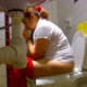 A camera hidden in a bathroom records a woman sitting on a toilet and picking her nose. Although no pooping sounds can be heard, we presume that is what she is doing because of how long she sits there and where she wipes herself.