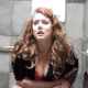 A redhead woman who looks a like a fat Nicole Kidman takes a melodramatic shit in a public restroom stall. There is audible pooping sounds and wet fart sounds. Over 4 minutes.