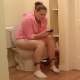 A hidden camera records a pudgy girl pissing, taking a shit, and then wiping herself. This looks like genuine voyeur. She appears to be a little constipated. About 12 minutes in length.