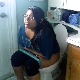 A chubby, mixed Asian girl records herself farting and taking a shit while sitting on a toilet at her home. Audible pooping. Presented in 720P HD. Over 3 minutes.