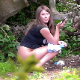 A plump, Eastern-European girl is voyeuristically recorded taking a shit in an outdoor location while speaking on her cell phone. Unfortunately, the poop action cannot be seen due to obstructing vegetation. Presented in 720P HD. Over 1.5 minutes.