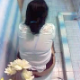Someone records an Hispanic woman taking a shit in a public restroom toilet and then wiping her ass. No pooping sounds are heard over the background noises, but her turd is clearly visible in the toilet when she stands up. Over 2 minutes.