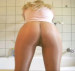 A close-up scene of a woman pooping in her panties.