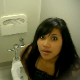 A girl is video recorded taking a shit in a public restroom. No pooping sounds can be heard, and the scene is somewhat brief.