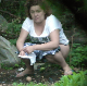 A plump, Eastern-European woman is voyeuristically recorded taking a piss in an outdoor location that appears to common dumping area for others. Presented in 720P HD. Over a minute.