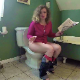 An American woman reading a newspaper takes a piss and a shit while sitting on a toilet. A close-up view of the poop action is shown. She wipes her ass and shows us her dirty toilet paper. Presented in 720P HD. Over 7 minutes.
