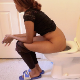 A shapely, black girl pisses in one scene and shits in a second scene while sitting on a toilet. Poop action is partially visible behind her ass. Product is shown in the toilet bowl at the end of the second scene. Presented in 720P HD. About 5 minutes.