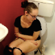 A brunette girl with glasses records herself taking a shit while sitting on a toilet in 5 different scenes. She shows her facial expressions as she makes clearly audible pooping sounds. Presented in 720P HD quality. Over 7.5 minutes.
