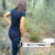 A low-quality video featuring a slender woman pooping in a forest setting.