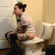 A girl with tattoos takes a piss and a shit while sitting on a toilet. Loose pooping can be heard. She talks about the spicy potato soup she ate the night before and how it can result in these types of shits. Presented in 720P HD. Over 3 minutes.