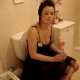 A cute Irish girl with tattoos takes a shit on a toilet. There are no audible pooping sounds, but she sure looks nice!