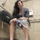 A girl sets up a camera in a public restroom stall and records herself taking a wet, explosive-sounding shit in multiple scenes. No poop action or finished products are ever shown. Over 7 minutes.