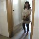 An unseen cameraman records a woman taking a runny shit into a floor toilet of a public restroom. He manages to get a look at her as she enters the bathroom. She never notices or suspects a thing. About 2.5 minutes.