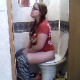 A pudgy, nerdy girl wearing glasses takes a shit while sitting on a toilet and wipes her ass. Audible plops. Decent video, although frame rate is slightly slower. About 4.5 minutes.