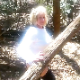 A pudgy, older blonde woman takes a chunky shit in a wooded, outdoor location while bending over with her ass to the camera. Over 1 minute.