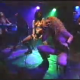 "Some punk rock concert footage featuring band members pissing into glass jars and pissing onto one another. Sounds like ""Lords Of Acid"". Maybe it is. They are pretty weird."
