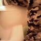 A young black woman wearing camo pants records herself shitting while sitting on a toilet. Face and action is not shown. Plop sounds are audible but not loud. About 12 minutes.