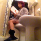A short-haired brunette girl with dyed highlights sits down on a toilet, smokes a cigarette, reads a book, takes a shit with some quick, heavy plops, and then pisses. Over 3 minutes.